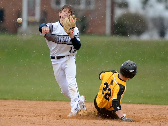 Dallastown's Cam Urey, seen here making a throw in a file photo, doubled and scored two runs in the Wildcats' 13-10 win over Dover on Monday.