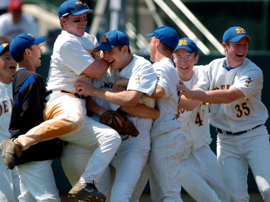 Moeller pitcher Eric Surkamp (fourth from left) is mobbed by David Oberly (third from left) and the rest of his team after they defeated St. Xavier High School 2-0 on May 29, 2004, in Oxford. The Crusaders won the state tournament in Canton that year.