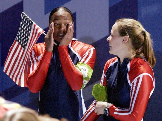 Vonetta Flowers, left, and Jill Bakken of the United States get emotional after their final and gold medal winning run in the two woman bobsled final at the 2002 Salt Lake City Winter Olympics in Park City, Utah.