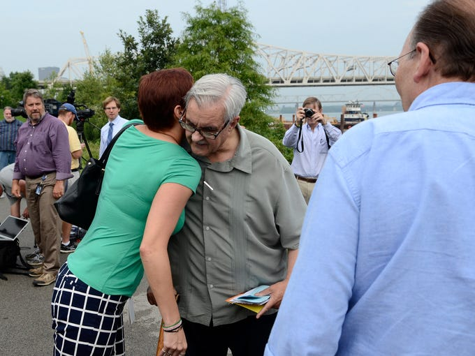 Sheldon Shafer, center, talks with Jessie Halladay and Ben Post, right, before a ceremony honoring him at Watterfront Park. August 11, 2014