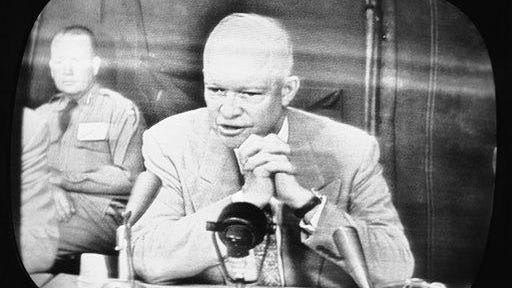 """U.S. President Dwight D. Eisenhower, shown on an NBC Television monitor television receiver June 15, 1955, in New York City as he reported to the nation on progress of the nationwide """"Operation Alert,"""" when the nation went underground during the simulated H-Bomb attack on June 15. Reporting from a secret headquarters within 300 miles radius of Washington, presumed flattened in the attack. The president headed the list of top official evacuated to various locations during the alert."""