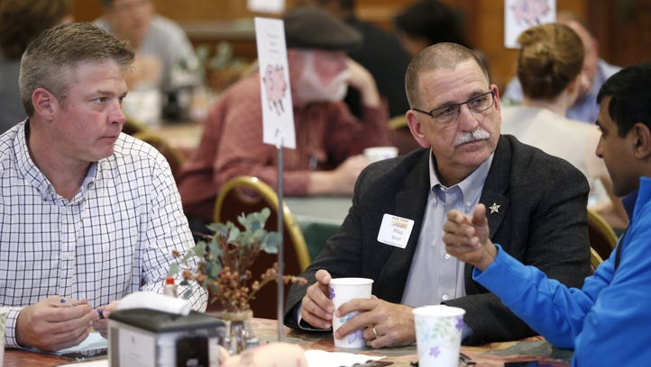 Leon County sherrif Mike Wood listens to local residents during a 'Speed Dating' event hosted by Village Square Thursday at St. John's Episcopal Church.