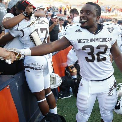 Western Michigan's Jamauri Bogan greets fans after