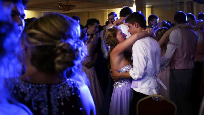 Kara Keshemberg and Alex Ulrich dance during the Appleton Area School District Senior Prom at the Radisson Paper Valley Hotel in Appleton, Wis., on Saturday, May 2, 2015. Ron Page/USA TODAY NETWORK-Wisconsin