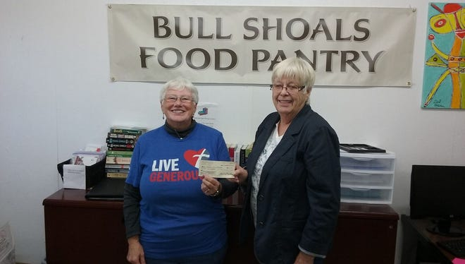 Anna Mattson, Thrivent Financial board member, left, presents a check for $800 to Peni Lloyd, treasurer of the Bull Shoals Food Pantry. This check was a grant from Thrivent Financial who with their members and other volunteers came together to help with Octoberfest.  Through its chapter programs, Thrivent Financial provides financial support and other resources for its members to help their communities and congregations through fundraisers and service activities. The Thrivent Financial Twin Lakes Arkansas Chapter 30452 works with groups like the Bull Shoals Food Pantry Octoberfest to connect congregations, institutions and volunteers to make a difference in peoples lives.
