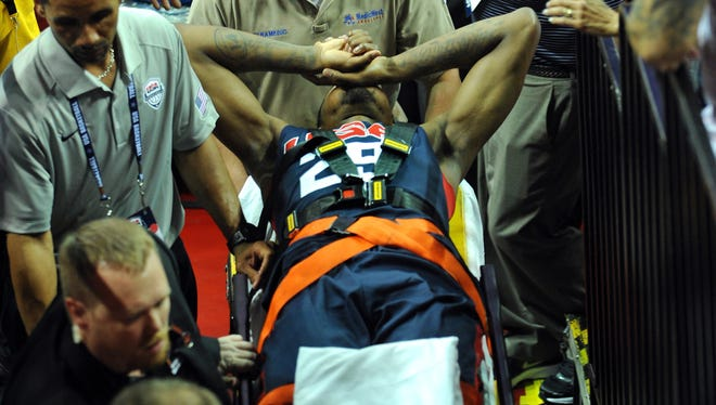 Paul George is carried off after injuring his leg during the USA Basketball Showcase at Thomas & Mack Center.