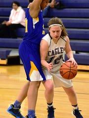 Thurston's Megan Abela (right) tries to get around
