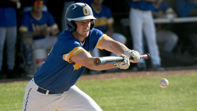 Ontario's Nick Arnold lays down a perfect bunt during the Warriors' MOAC clinching win over Clear Fork on Monday.