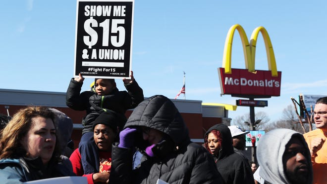 February 12, 2018 - Doneshia Babbitt holds her 6-year-old cousin, Tielynn Johnson, both of St. Louis, Mo., as they join protesters outside McDonald's, located at 2073 Union, demanding a $15 minimum wage. The Memphis City Council is considering raising full-time employees' wages to $15 an hour.