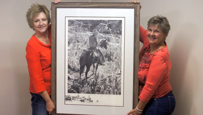 """BorderBelle members Kim Allen, left and Gwyn Ruebush hold the Robert """"Shoofly"""" Shufelt limited edition reproduction print that will be raffled off in October."""