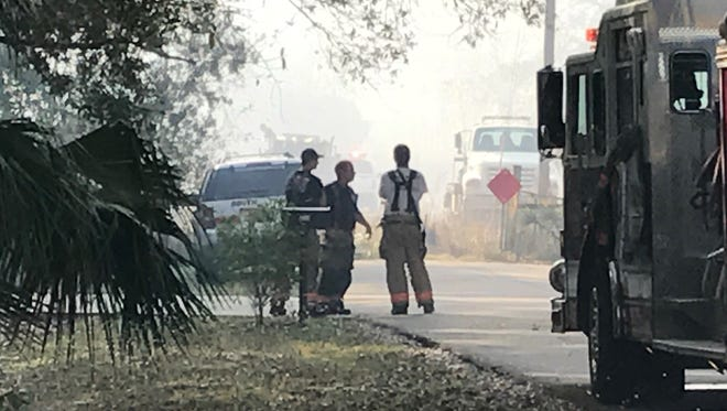 North Strike Team fire fighters take a break while fighting a 20-acre fire in eat Lee County on Sunday. The fire was ruled arson and two juveniles have confessed to setting it.