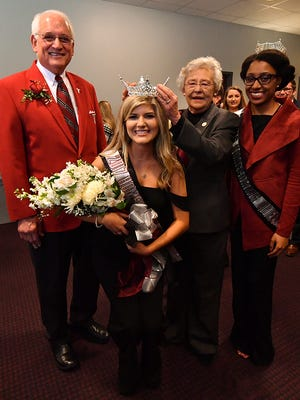 Amy Russo is crowned Troy University's 2017 homecoming queen by Alabama Gov. Kay Ivey along with TROY Chancellor Dr. Jack Hawkins Jr. and 2016 homecoming queen Destiny Oliver.