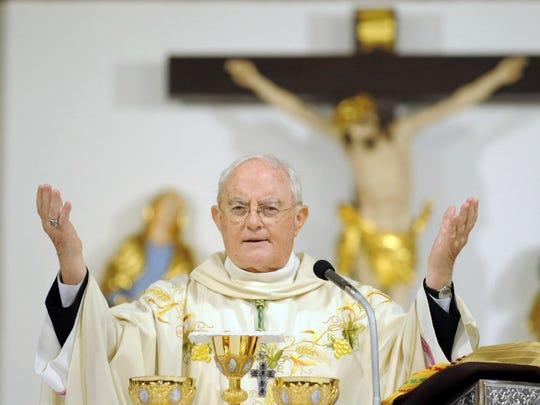 Archbishop Henryk Hoser celebrates a Mass at St. Florian's