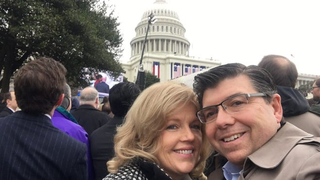 Assemblyman Anthony Bucco with his wife, Amy, as they prepare to take their seats on the Capitol lawn for the inauguration of President Donald J. Trump.