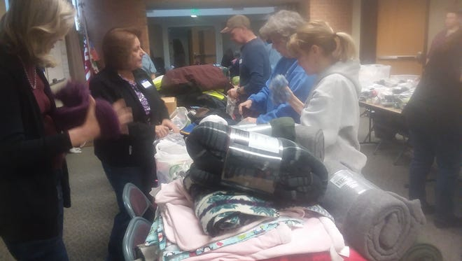 Teams of people gathered in Indianola to pack up supplies for Warren County's homeless population. Supplies will be delivered to city parks on Jan. 31.