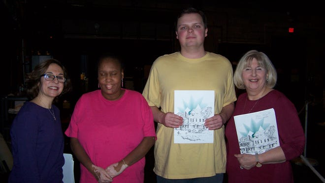 Melody Lucas (center left) and Adam Fleissner, members of Community Access Unlimited, are flanked by Lyn Schraer-Joiner (left) of Kean University Marguerite Modero of CAU backstage before the concert.