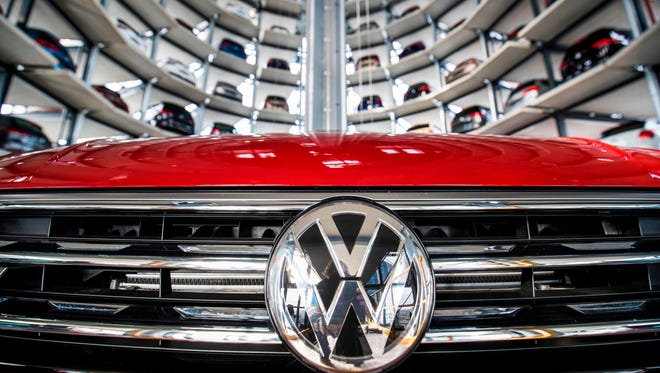 In this file photo taken on March 14, 2017 German carmaker Volkswagen's cars at the storage facility auto tower at the company headquarters in Wolfsburg on March 14, 2017.