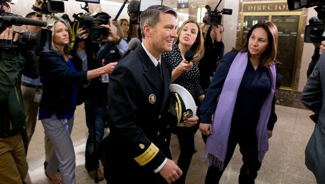 Navy Rear Admiral Ronny Jackson (C), President Trump's nominee to be Secretary of Veteran Affairs, is followed by members of the news media following a meeting in the office of Senator  Jerry Moran (R-Kan.), on Capitol Hill in Washington, DC, on April 24, 2018. The Senate Veterans Affairs Committee has postponed Jackson's confirmation hearing amid allegations involving his behavior as a White House physician. If confirmed by the Senate, Jackson would fill the vacancy left by the exit of David Shulkin.