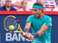 Dominic Thiem of Austria serves to Marin Cilic of Croatia during the Rogers Cup men's tennis tournament Thursday, Aug. 8, 2019, in Montreal. (Paul Chiasson/The Canadian Press via AP)