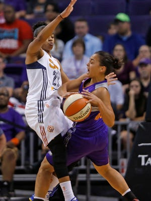The Mercury's Leilani Mitchell (right) collides with the Sun's Alex Bentley in the first half to draw a foul at US Airways Center in Phoenix on June 19, 2015.
