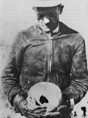 Brownie Holmes, shown here holding the skull of Adolph Ruth, was part of a search party that in 1932 after a year-and-a-half after he went missing found the remains of the Lost Dutchmen Mine prospector Ruth.