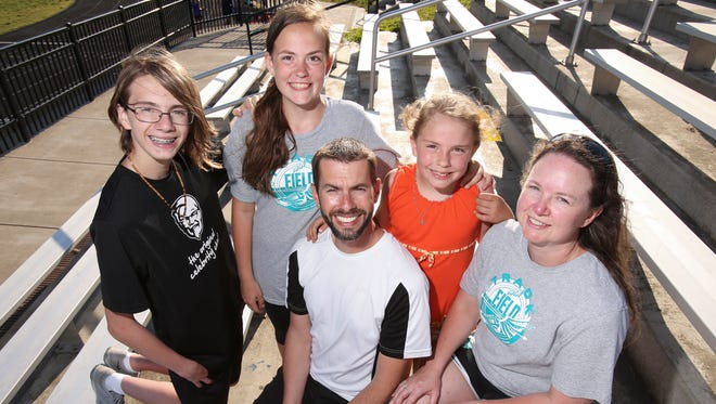 (L-R) Hayden Roberts, 14, his sister Nichole Roberts, 14, their dad Sean Roberts, their sister Alexis Roberts, 7, and their mom Cindy Roberts are a family blended by adoption.  Sean and Cindy adopted Nichole and Alexis to add to their existing family with their biological son Hayden and a college age daughter. May 16, 2017