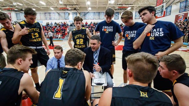 Kettle Moraine varsity boys basketball coach Brad Bestor talks with players during the game at Arrowhead on Friday, Dec. 1, 2017.