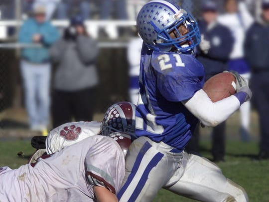 Manasquan's Kaysonne Anderson runs for yardage against Matawan in 2002.