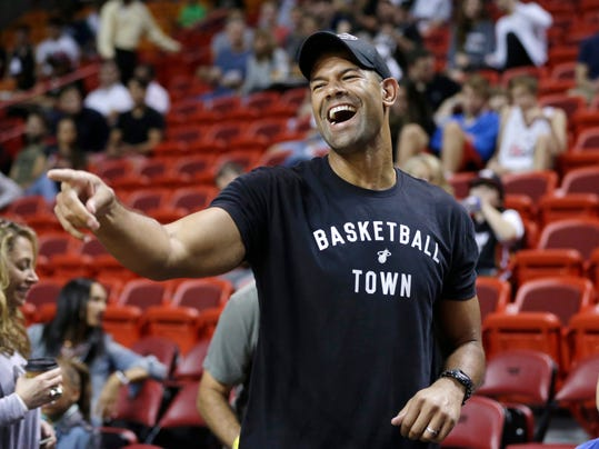FILE - In this Dec. 20, 2015, file photo, former Miami heat player Shane Battier gestures to his former teammates before an NBA basketball between the Miami Heat and Portland Trail Blazers in Miami. Battier was hired Thursday, Feb. 16, 2017, to lead the new analytics department for the Miami Heat, the team he helped win NBA championships in 2012 and 2013. (AP Photo/Lynne Sladky, File)