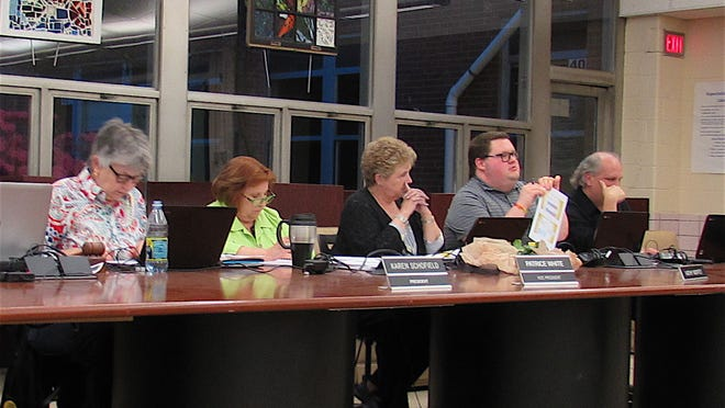 The Cuyahoga Falls Board of Education is pictured at a meeting in 2019. Pictured from left are Board President Karen Schofield, board member Patrice White, board member Kathy Moffet, Board Vice President Anthony Gomez and board member David Martin. The board on Wednesday approved the second of two steps that were needed to place a levy renewal request on the Nov. 3 ballot.