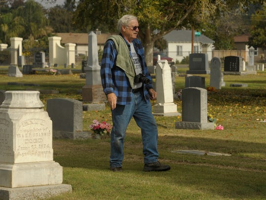 Phil Hutson, of Visalia, spends much of his time at Visalia Public Cemetery, where he learns the stories of those buried at the grounds. The information Hutson gathers is then put on Find A Grave, a cemetery records website. Hutson, pictured, finds, cleans, and photographs the headstones and markers as if they were his family members, with care.