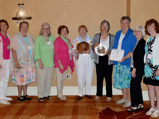 Standing left to right are Neshanic Garden Club members Diana Reinhardt, Barbara Majewski, Marylin Hulme, Teri Halvorson, Co-President Kathy Herrington, Co-President Cathy Heuschkel, Barbara Zielsdorff, Carmella Shepley, and Marion Nation with the awards that were presented to the club.