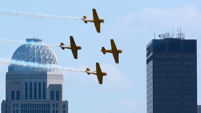 The Canadian Harvard Aerobatic Team performs in the Thunder Over Louisville Air Show Saturday late afternoon. April 23, 2016.