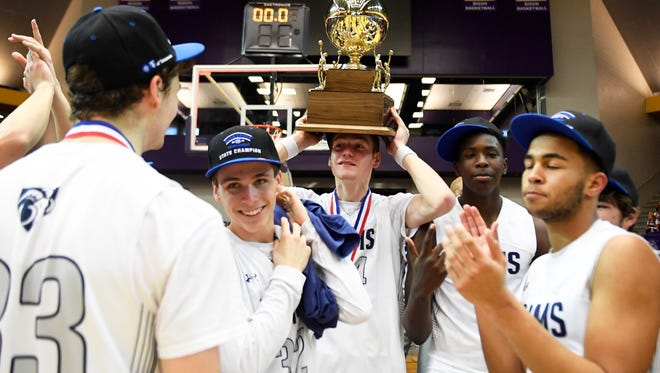 Grace ChristianÕs Baylor Younker (44) carries the trophy on his head after a Division II-A boys basketball championship game at Lipscomb University Saturday, March, 3, 2018. Grace overcame Webb 46-44 in the final minutes of the game.