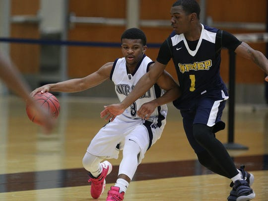 UPrep's J.J.Strothers (1) presses Gates Chili's Keith Slack near mid-court.