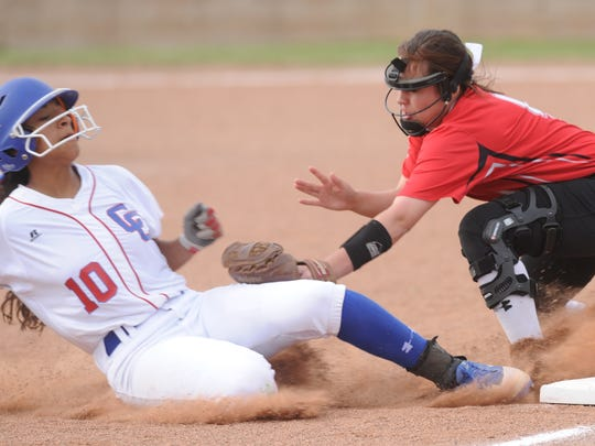 Lubbock Cooper third baseman Posey Pence, right, tags out Abilene Cooper's Keiana Kemp, who was trying to steal third base in the fourth inning. Lubbock Cooper won the District 4-5A game 13-2 in five innings Friday, March 23, 2018 at Cougar Diamond.