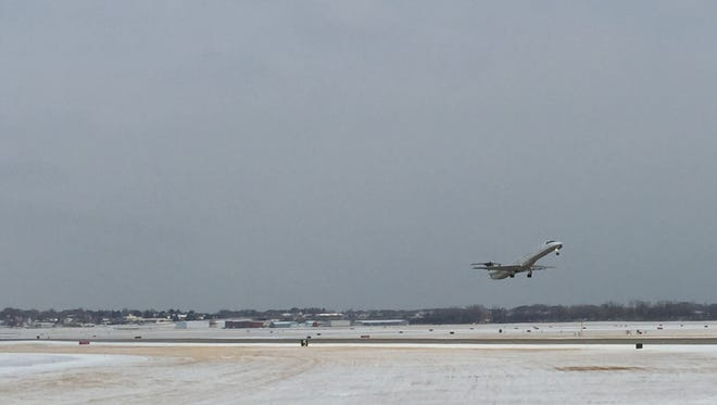 A jet takes off from Milwaukee's Mitchell International Airport in January on a day when snow was in the forecast. Winter weather is something airports in the upper Midwest deal with regularly this time of year.