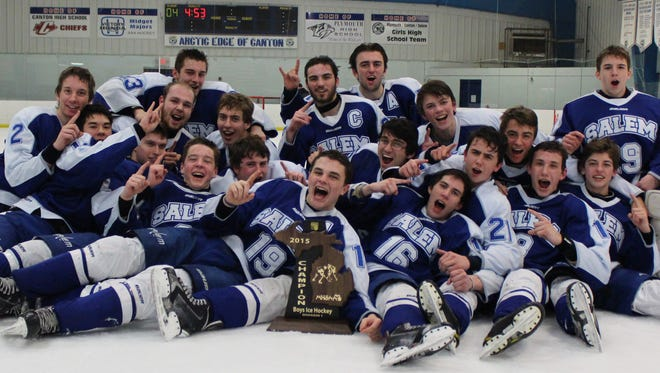 Salem's varsity boys hockey team capped off an unbelievable week with Friday's victory over Brighton at Arctic Edge to win a Division 1 regional title. Here, the Rocks celebrate on the ice following their big win.