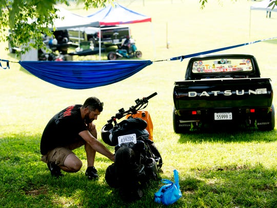 Drew Kennedy, of Knoxville, polishes his Honda Ruckus