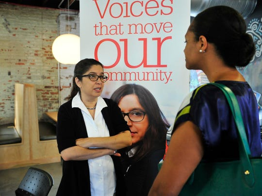 Reporter Anita Wadhwani talks with Juanita Traughber during a Meet the Reporters event  June 30, 2015, at The Bistro in Nashville.