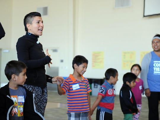 Ana Maria Alvarez, artistic director of CONTRA-TIEMPO, leads instruction on Wednesday at CSUMB.