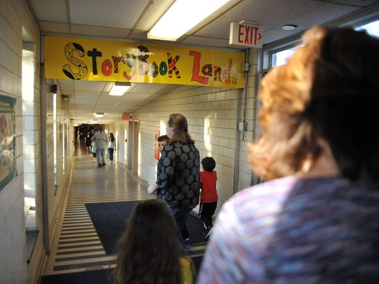 Students and grown-ups head toward 'Storybook Land' during Rieck Avenue Elementary's Adventures in Learning event Wednesday.