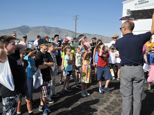 Richard Brong of Civil Air Patrol teaches kids about flight at a Young Eagles First Flight event.