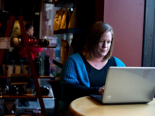 Brenda Boitson of Lancaster uses her laptop at the Prince Street Cafe in Lancaster recently. Boitson comes to the cafe often to blog about her experiences. Her husband, Kevin, died unexpectedly in 2008 and she has used social media as a coping mechanism since then.
