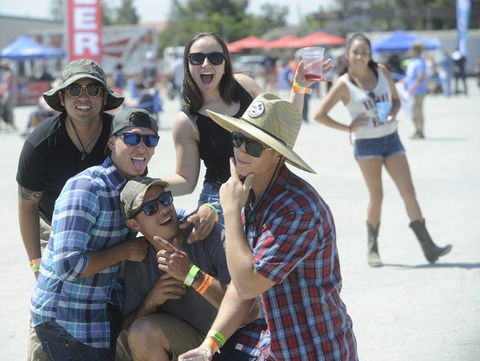 Country music fans braved the heat and headed to the