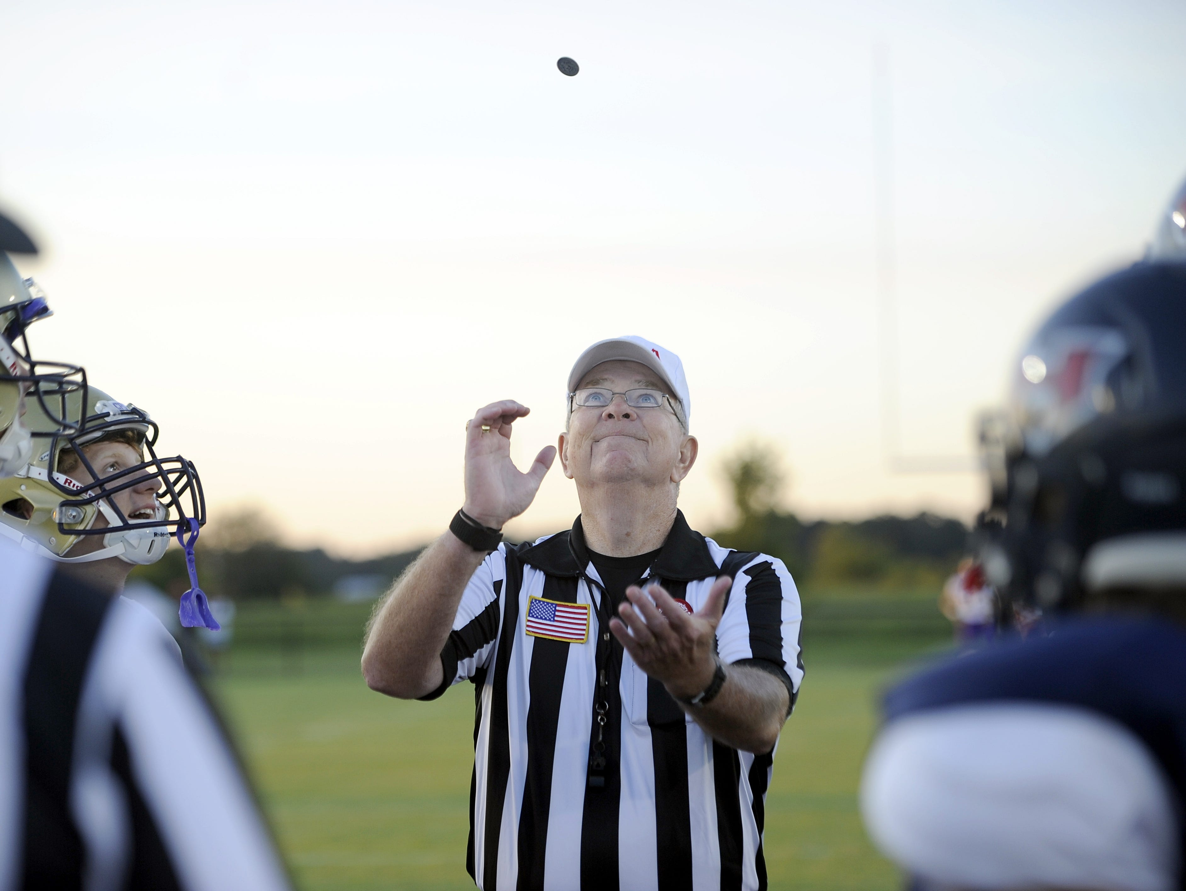 North Middle Football Officials Association referee Jody Swearingen flips the coin prior to kickoff of last Friday's Christ Presbyterian Academy/White House Heritage game.