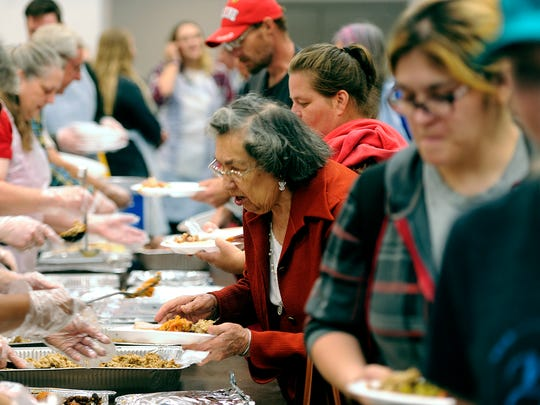 Diners get their plates filled in the serving line during the Veterans Service Office's Operation Thanksgiving meal on Thursday, Nov. 24, 2016, at the Abilene Civic Center.