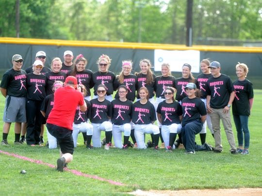 The Wilson Memorial softball team took a photo with NASCAR Xfinity driver Quin Houff and his mom, cancer survivor Kate Houff (right) before Tuesday's cancer awareness game against Stonewall Jackson.