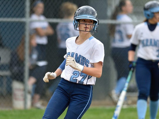 Paramus' Samantha Settecasi scores a run in the game