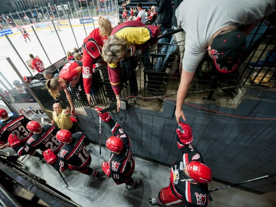 The fans high-five the Griffins as they walk onto the
